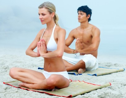cutcaster-100356162-A-man-and-a-woman-meditating-together-at-the-beach-medium.1-e1332274544952